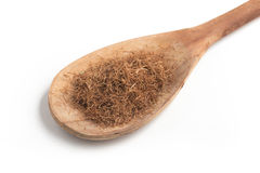 Dry Corn Silk Herb into a spoon. Stigmata Maydis. Dry Corn Silk Herb into a spoon isolated in white background. Stigmata Maydis royalty free stock photos