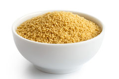 Dry couscous in white ceramic bowl. Stock Photography