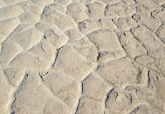 Dry cracked and caked lakebed in desert Stock Photography
