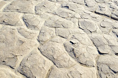Dry cracked and caked lakebed in desert Stock Photos