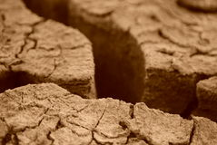 Dry cracked earth. The amazing view.. is it the dry ground or deep canyons royalty free stock images