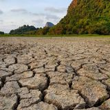 Dry cracked earth background. Environment hot heat summer rice paddy farmland Thailand agriculture royalty free stock image