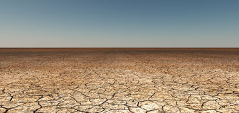 Dry cracked earth. Dry cracked desert earth recedes into distance royalty free stock images