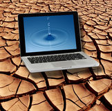 Dry Cracked Earth & Pure Water on Laptop Screen. Pure water on the screen of a laptop on dry and cracked earth in the Namib Desert in Namibia stock photos
