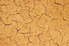 Dry cracked mud wall background texture pattern. Stock Photo