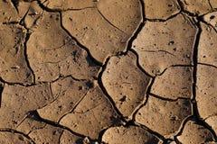 Dry cracked mud stock photos