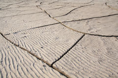 Dry and cracked sand soil Stock Photos