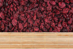 Dry cranberries and bamboo mat Stock Images