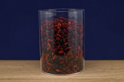 Dry cranberries and goji in a bowl against blue background Stock Image