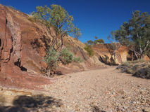 Dry Creek lined with Ochre pits. Along the banks at midday in the McDonnell Ranges, Alice Springs, Australia, July 2015 Royalty Free Stock Photos