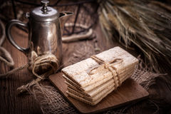 Dry crisp breads. Dark light. Stock Image