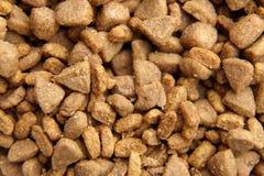 Dry crisp pet food as background stock photos