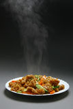 Dry crispy beef in soy sauce. And vegetables royalty free stock image