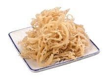Dry crispy white seaweed in white plate Stock Image