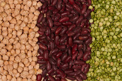 Dry crushed green peas, chickpeas and red beans. Different colors of healthy food. Territory taste. Grains and kernels Royalty Free Stock Photography