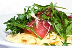 Dry cured ham. With herbs and pasta Royalty Free Stock Image