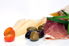 Dry cured ham. With herbs and olives Royalty Free Stock Photo