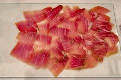Dry cured ham jamon slices royalty free stock photo