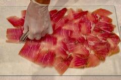 Dry cured ham jamon slices stock image