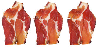 Dry Cured Pork Neck Slices Isolated On White Background. Delicious, aromatic, gourmet, three Dry Cured Pork Neck slices, isolated on White background Stock Photo