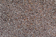 Dry dash aggregates coating wall. Background made of a closeup of a wall plastered with a dry dash aggregates coating royalty free stock photo