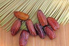 Dry dates. Dryed dates on a wood background royalty free stock photos