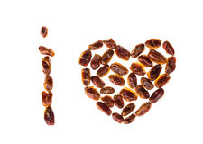 Dry dates in form of heart. Stock Image