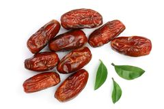 Dry dates with green leaves isolated on white background. Top view. Flat lay pattern.  Stock Image