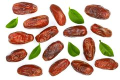 Dry dates with green leaves isolated on white background. Top view. Flat lay pattern.  Royalty Free Stock Photography