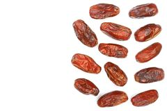 Dry dates isolated on white background with copy space for your text. Top view. Flat lay pattern.  Stock Image