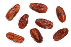 Dry dates isolated on white background. Top view. Flat lay pattern.  Royalty Free Stock Images