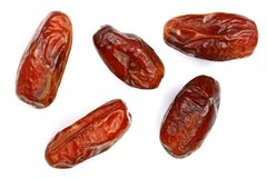 Dry dates isolated on white background. Top view. Flat lay pattern.  Royalty Free Stock Photos