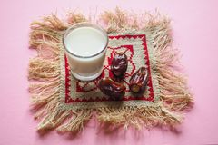 Dry tasty dates and milk on pink background. Dry dates and milk on pink background Royalty Free Stock Images