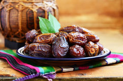 Dry dates on oriental ceramic plate with empty space Royalty Free Stock Image
