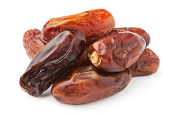 Dry dates pile. Against white background Royalty Free Stock Photography
