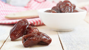 Dry dates served on a white wooden table in a rustic kitchen. Empty copy space Royalty Free Stock Photography