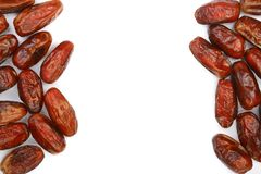 Dry dates  on white background with copy space for your text. Top view. Flat lay pattern.  Stock Photos