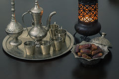 Dry dates and zam zam water cups with lantern Stock Photos