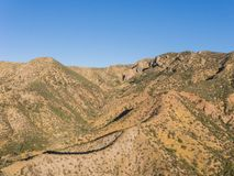 Dry Desert Hillside with Boulders. Dry ridgeline of desert hillside in rocks cliffs and boulders in southern California Stock Photography