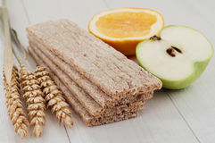 Dry diet crisp breads with ears of wheat and fruit Stock Images