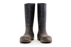 Dry dirty Mud boots isolated on white front view Stock Photos