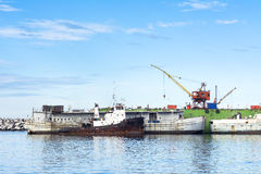 Dry dock. A drydock ship repair yard in Ensenada Mexico shoing two old, work out boats getting ready to be refurbished Stock Image