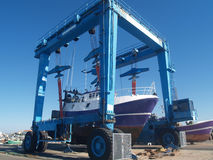 Dry dock. A fishing boat being lifted in dry dock Stock Photography