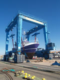 Dry dock hoist. A fishing boat being lifted in dry dock Stock Image