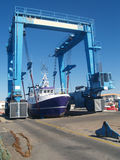 Dry dock hoist. A fishing boat being lifted in dry dock Royalty Free Stock Photo