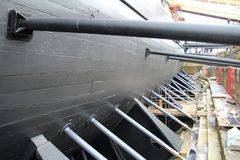 Dry Dock. Old wooden naval warship in a dry dock Stock Image