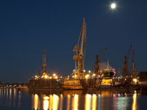 Dry dock in the shipyard. Dry dock in the moonlight at the shipyard in Gdansk, Poland Royalty Free Stock Photos