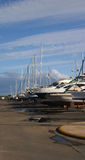 Dry Docked. Various boats in a row out of the water royalty free stock photos