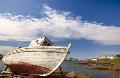 Dry-docked on Change Island Newfoundland Canada. An old, dry docked fishing boat sits on the land at Change Island, Newfoundland Canada stock photo