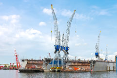 Dry docks and cranes in shipyard Stock Photos
